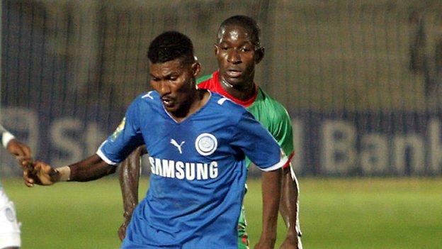 Al-Hilal's Haitham Karar (left) controls the ball next to Djoliba AC's Salif Coulibaly during their Confederation Cup semi-final first leg