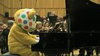 Pudsey plays the piano