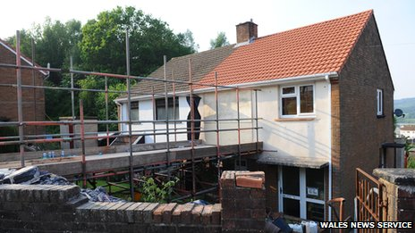 Rescue services in Wales cut into to the top floor of a house to rescue a young obese woman