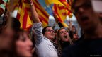 Supporters of Catalan Nationalist Coalition wave their independent flags at the start of the campaign in Barcelona