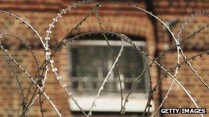 Prison window behind barbed wire