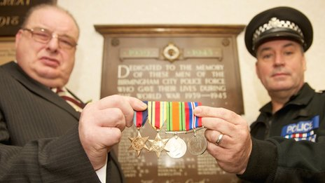 Mr Jones (left) is presented with four medals by Sgt Steve Rice