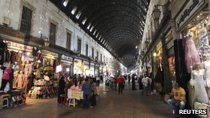 Shoppers walk in the al-Hamidieh Souk in the old city of Damascus, 8 November 2012