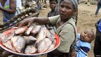 A woman buying fish in a market in eastern DR Congo - Saturday 3 November 20