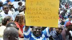 Nigerian tennis fan in Lagos holding up a sign reading: &quot;I am the Nigerian husband Serena never had&quot; - Friday 2 November 2012