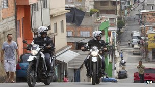 Motorcycle policemen patrol the Paraisopolis slum in Sao Paulo, Brazil, on 2/11/12