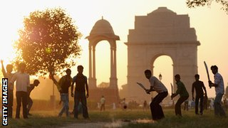 Children play cricket in India