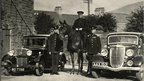 Mounted officer and cars