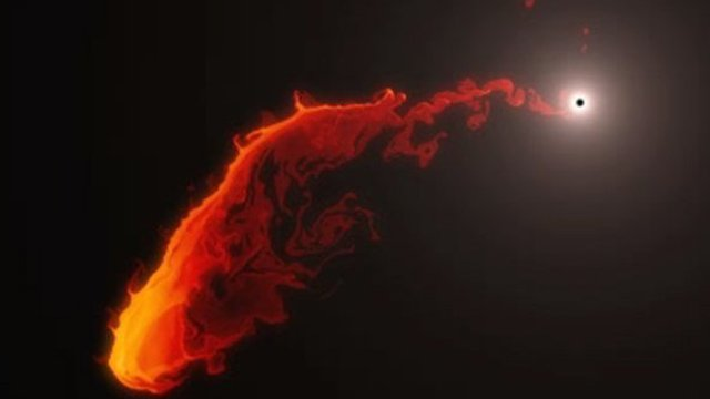 This simulation shows the future behaviour of a gas cloud that has been observed approaching the supermassive black hole at the centre of the Milky Way.