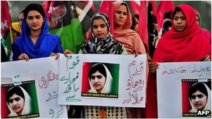 Supporters of the ruling Pakistan People&#039;s Party hold placards in support of Malala Yousafzai in Islamabad, Pakistan