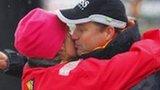 Sam Davies and Alex Thomson embrace before setting sail