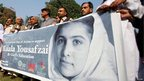 Civil society activists hold a banner in support of Malala Yousafzai in Peshawar, Pakistan