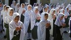 Students pray for the health of Malala Yousafzai at a school in Mingora, Pakistan