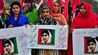Supporters of the ruling Pakistan People's Party hold placards in support of Malala Yousafzai in Islamabad, Pakistan