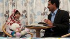 Malala Yousafzai in the Queen Elizabeth hospital with her father Ziauddin Yousafzai