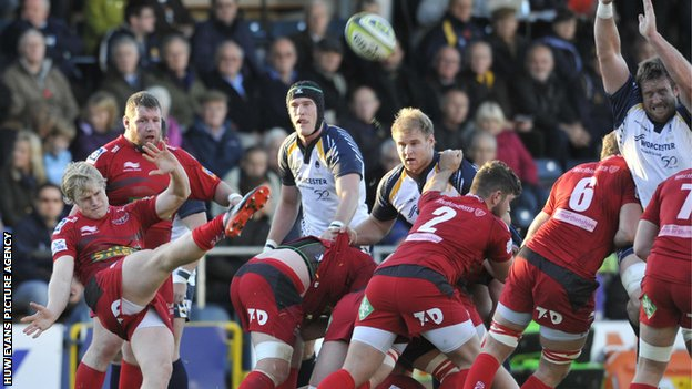 Scrum-half Aled Davies clears for Scarlets