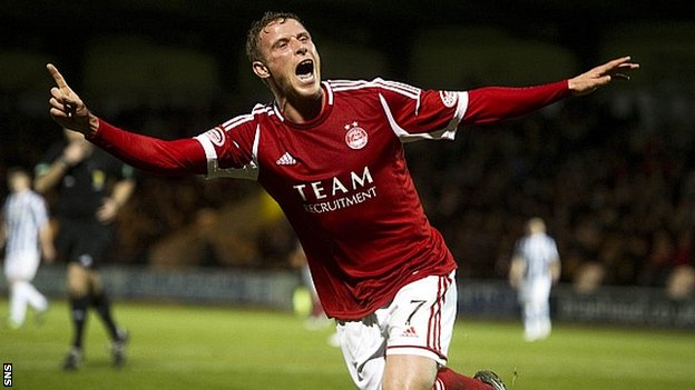 Chris Clark celebrates knocking home Aberdeen's third goal in Paisley