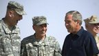 Gen David Petraeus (centre) with President George W Bush, in Anbar province, Iraq, 2007