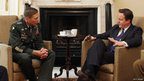 General David Petraeus meets with British Prime Minister David Cameron 10 Downing Street on 22 March 2011 in London, England.