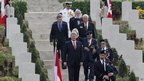 Canadian Prime Minister Stephen Harper front left, accompanied by Canadian veterans and officials.