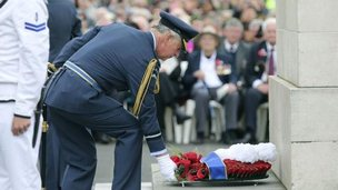 Prince Charles laying a wreath