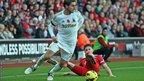 Swansea defender Angel Rangel leaves Southampton's Adam Lallana in his wake