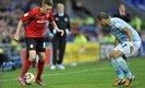 Cardiff's Craig Noone takes on Hull City's Liam Rosenior during the Championship clash at Cardiff City Stadium.