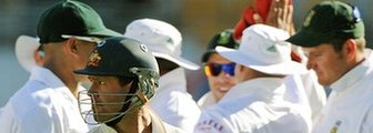 South Africa celebrate the dismissal of Ricky Ponting (centre)