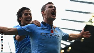 Edin Dzeko (right) celebrates with David Silva