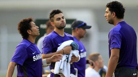 "India""s Sachin Tendulkar, left, speaks with teammate Virat Kohli, center, and Yuvraj Singh during a cricket practice session in Mumbai, India, Friday, Nov. 9, 2012."