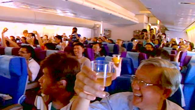 Passengers celebrate on a plane