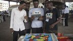 Nigerian students use an ipad and an electrified map of Nigeria to learn about geography