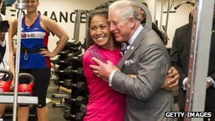Prince Charles hugs rugby player Linda Itunu
