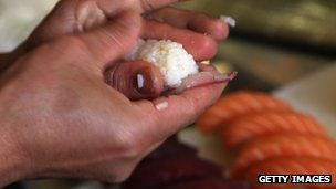 chef making sushi dish