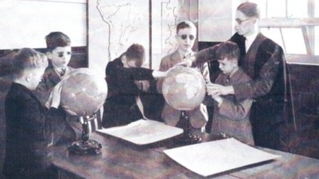 Pupils use braille world globes in geography
