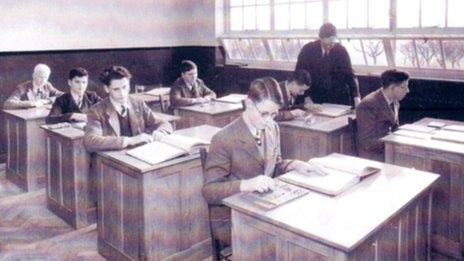 Pupils working in a classroom at Worcester College in the 1930s