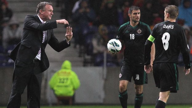 Michael O'Neill gives instructions during the Portugal game