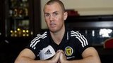 Kenny Miller addresses the media