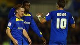 Charlie Strutton (left) celebrates his goal