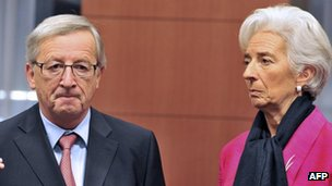Luxembourg Prime Minister and Eurogroup president Jean-Claude Juncker (L) speaks with International Monetary Fund Managing Director Christine Lagarde