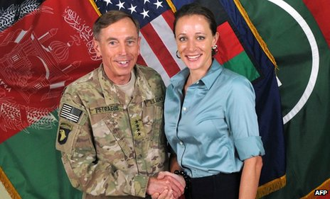 This July 13, 2011 handout image provide by Nato, shows then Commander General David Petraeus shaking hands with his biographer Paula Broadwell in Afghanistan