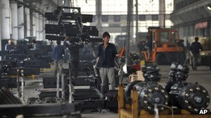 A worker at a bus manufacturer in Dandong City, Liaoning province, 20 October 2012