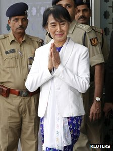 "yanmar""s opposition leader Aung San Suu Kyi makes a gesture of greeting upon her arrival at the Indira Gandhi international airport in New Delhi November 13, 2012."