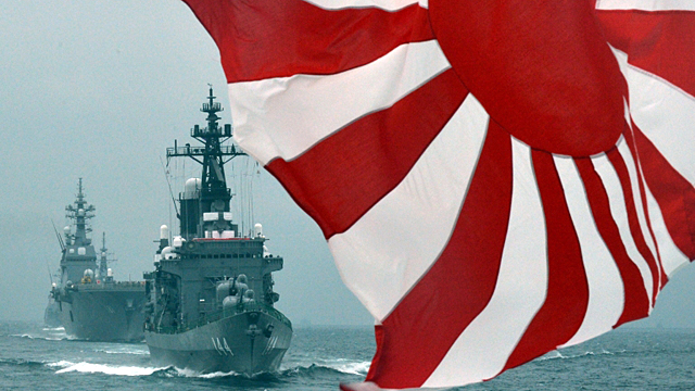 Japan steps up threat on China ship