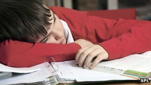 Boy asleep on desk