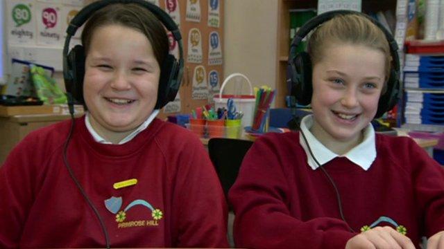 Schoolchildren listening to music