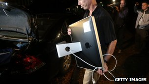 FBI agent carrying computer