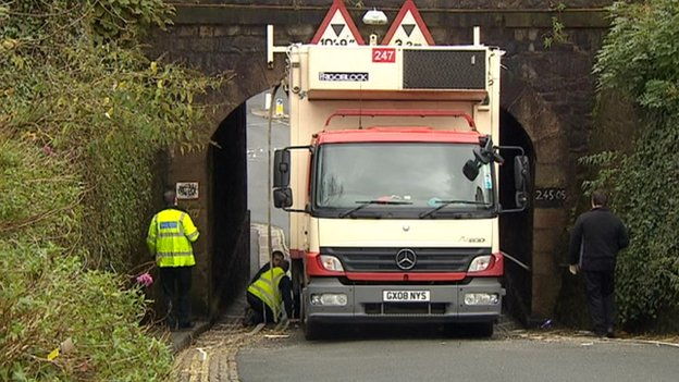 Lorry stuck under Plymouth rail bridge