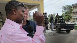 The BBC's Andrew Harding interviews Mohammed Nur on a street in Mogadishu