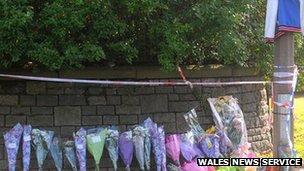 Floral tributes outside Ely fire station